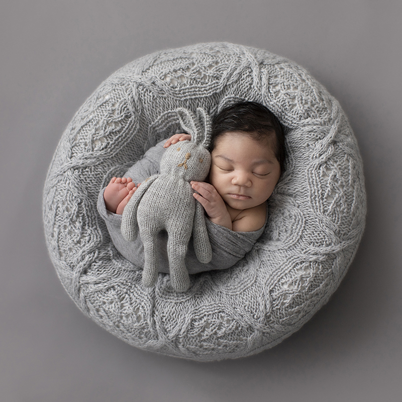 newborn posing bean bag